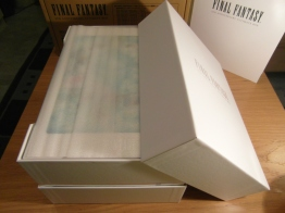 Open the box to reveal the contents wrapped in a thin protective layer.