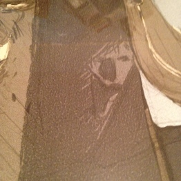 Close up of Squall's reflection in Seifer's blade.