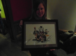The framed print signed by Nomura. (This photo is a little dark)