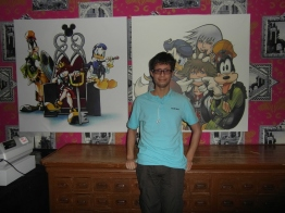 Another photo of my friend with the wall prints.