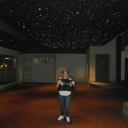 Me, outside the hotel by the entrance. The starry ceiling could have been something right out of the game :3